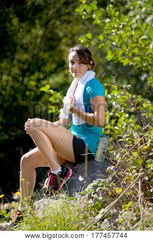 beautiful sporty young woman relaxing after exercising