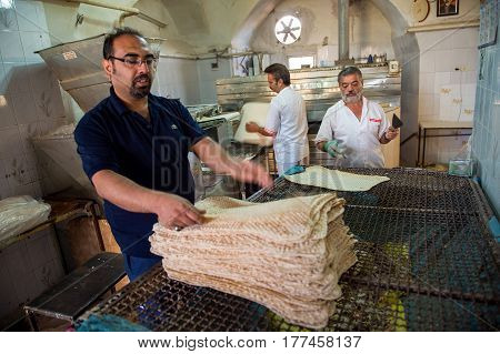KASHAN IRAN - October 21 2016 : Naan (bread) taftoon factory Iranian small bakery shop in Kashan city. Kashan nowaday is one of a popular destination in Iran.