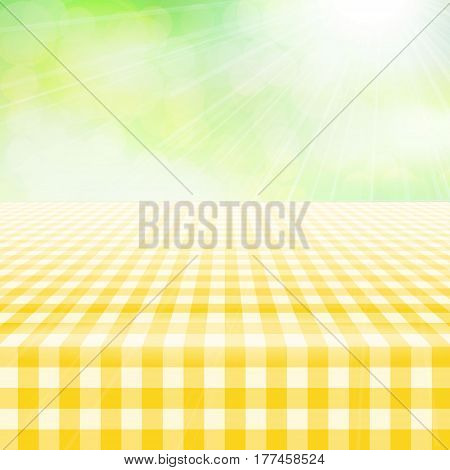Empty picnic table covered with checkered gingham tablecloth. Blurred green background. Summer picnic background for product presentation Vector illustration. Yellow gingham pattern