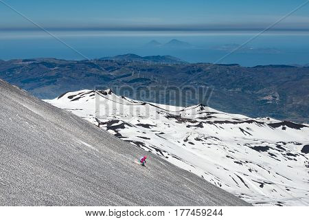 Skiing On The Etna Volcano With The Background Of Lipari Stromboli Aeolian Islands
