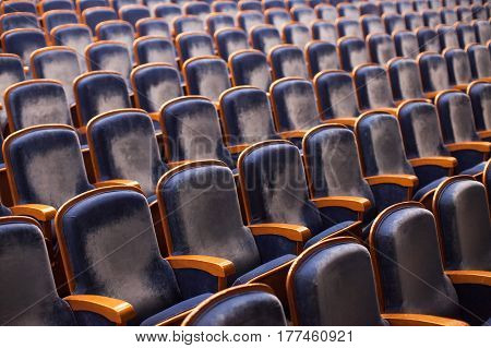 Empty blue seats in theater auditorium. Conference concept.
