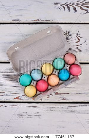 Box with colored eggs. Easter eggs tray, top view.