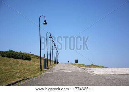 Photo of a way park with streetlight, blue sky and sunlight