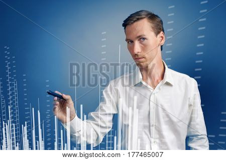 Finance data concept. Man working with Analytics. Chart graph information on digital screen.