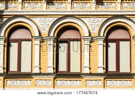 Arched windows with decorated brick stone background