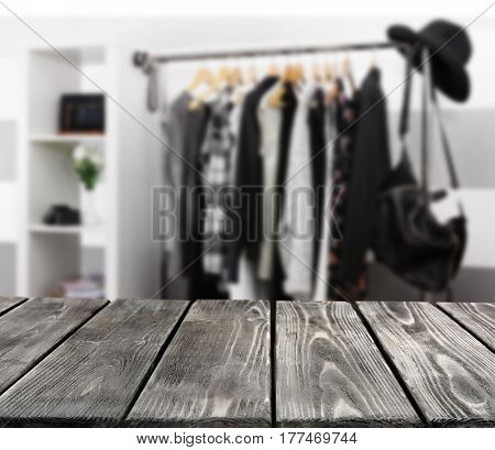 Wooden table on blurred showroom background