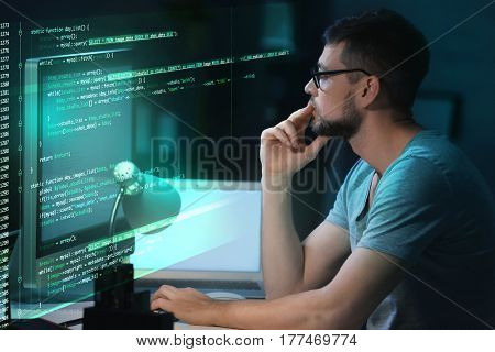 Program development concept. Young man working with computer