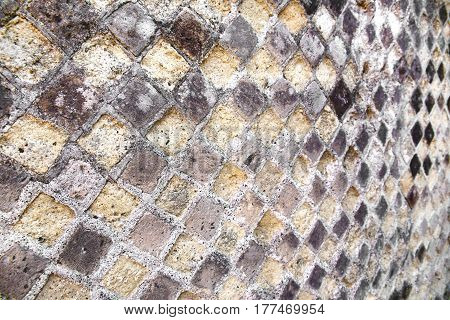 Pompeii mosaic walls from travertine - volcanic material. Details. Selective focus