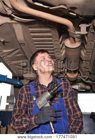 Car mechanic working in auto repair service station