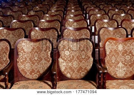 Vintage theatrical armchairs. An interior of theatre