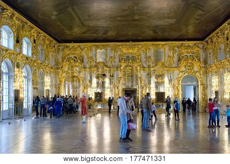TSARSKOYE SELO, SAINT-PETERSBURG, RUSSIA -- FEBRUARY 14, 2016: People in The Great Hall (Bright Gallery) in The Catherine Palace. The Tsarskoye Selo is State Museum-Preserve.