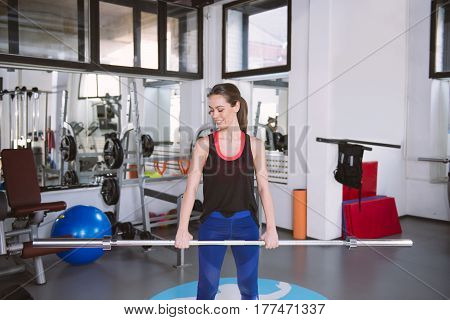 Attractive Fit Woman In Gym Exercising With Weights