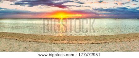 White sandy beach Le Morne at sunset. Mauritius. Panorama