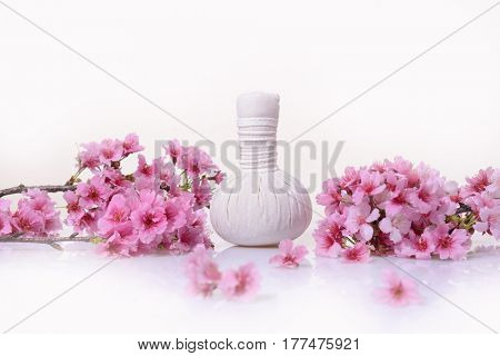 Tropical Spa with blooming branch with herbal, ball,
