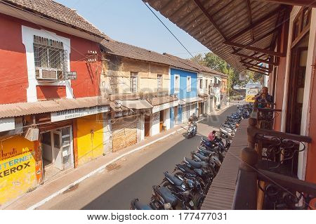 GOA, INDIA - MAR 1, 2017: Old part of town with small buildings and the cozy old style cafe with balconies on March 1, 2017. Near 5 million tourists visit Goa annually