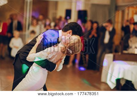 bride and groom dancing at the restaurant first dance
