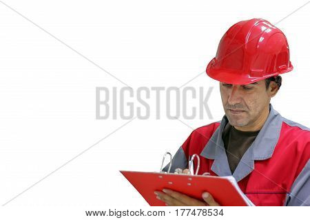 Engineer isolated over white background. Worker in red uniform and safety helmet writing on clipboard.