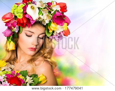Spring portrait. Beauty Woman hairstyle with flowers