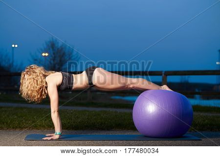 Fitness woman using a yoga ball during her workout
