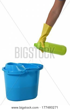Detail of a hand pouring detergent into a mop bucket
