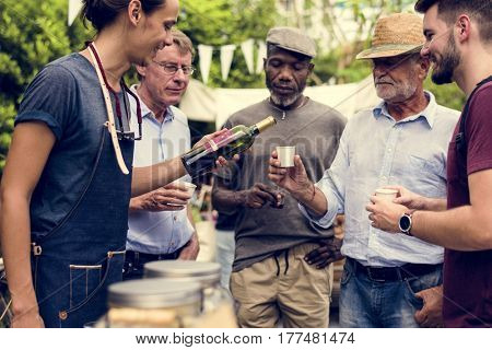 Group of men drinking local red wine together