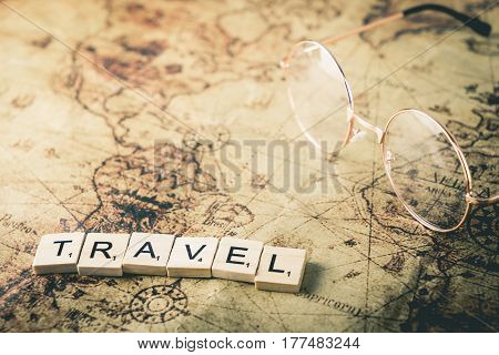 Vacation concept scrabble text on vintage map with copy space