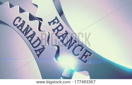 France Canada on the Mechanism of Shiny Metal Cog Gears with Lens Effect - Communication Concept. France Canada Metal Cog Gears - Enterprises Concept. with Glowing Light Effect. 3D.