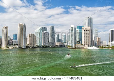 Aerial View Of Miami Skyscrapers With Blue Cloudy Sky, Boat Sail