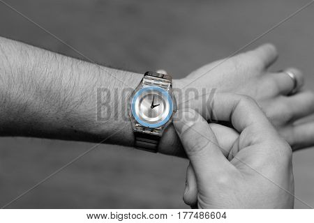 Picture of someone adjusting their watch for the summer time daylight savings