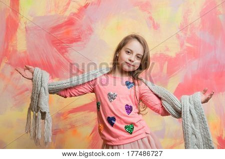 Small Happy Baby Girl In Pink Scarf And Shirt