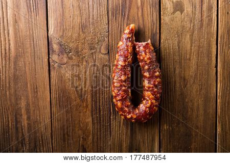 Homemade sausages on a wooden background. Sausages.. Sausages and salami. Copyspace