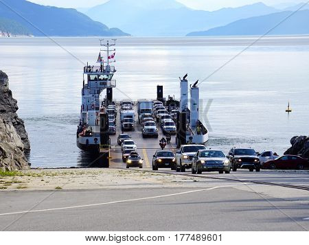 Ferry unloading vehicles at end of journey