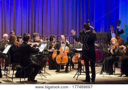 DNIPRO UKRAINE - MARCH 20 2017: FOUR SEASONS Chamber Orchestra - main conductor Dmitry Logvin perform at the State Drama Theatre.