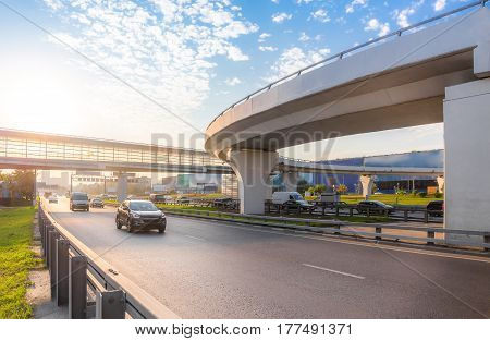 Highway interchange with bridge on the background