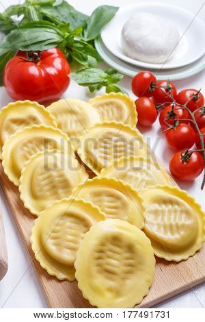 Raw Stuffed Ravioli on a Cutting Board