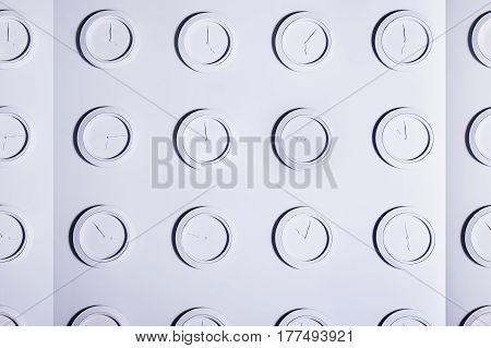 White Background With Identical Round White Not Numeral Wall Clocks. Time Concept Background