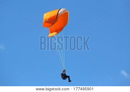 Paraglider descending under the big ears technique