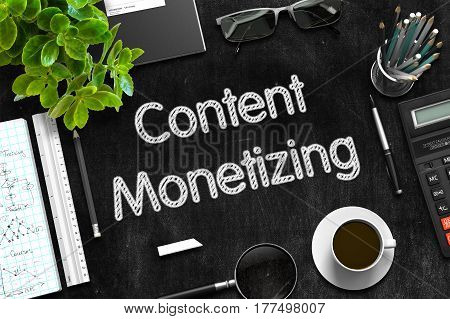 Content Monetizing. Business Concept Handwritten on Black Chalkboard. Top View Composition with Chalkboard and Office Supplies. 3d Rendering.