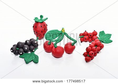 Berries made from plasticine. Isolated on white background.