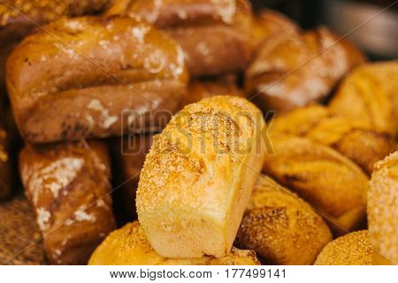 Fresh bread from cereals with seeds from a bakery. Healthy and nutritious food. The product contains carbohydrates.