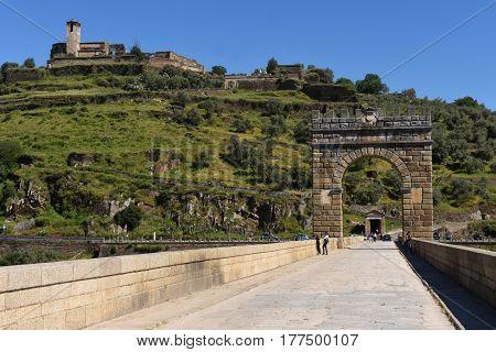 Roman Bridge Over The Tajo River In Alcantara, Extremadura, Spain