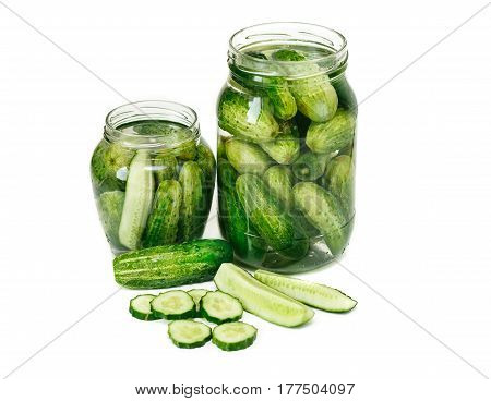 Preserved cucumbers in jars. White isolated background.