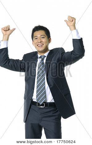 Successful young businessman smiling with hands rising