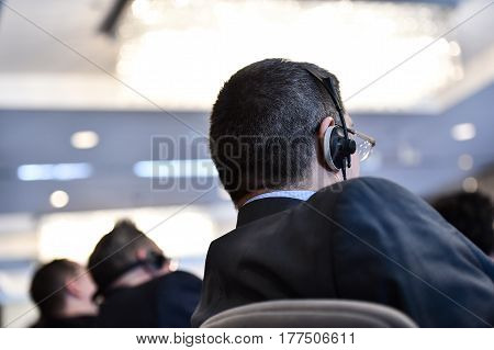 Business People Using Headphones For Translation