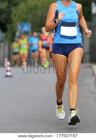 Woman Athlete Running At The Marathon