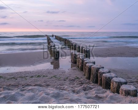 Wooden breakwaters on a shore of the Baltic Sea