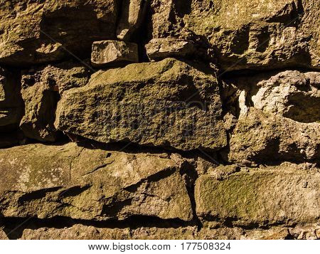 Rock wall:background,ilustration,pattern.Close view on the rock wall