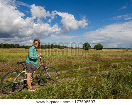 A woman on a bicycle during a trip along the Bug River