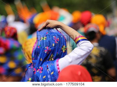 Sikh Women With Veils Over Their Heads During The Festival In Th