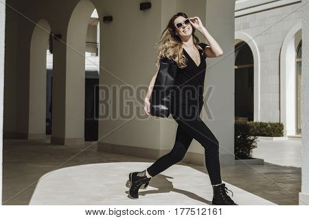 Happy Luxury Fashion Blonde Hair Woman In Sunglasses With Shopping Bags Walking At Street